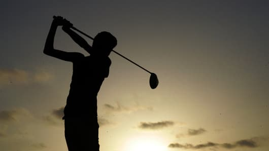 Kid playing golf, silhouette
