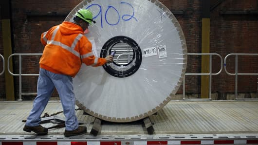 A worker loads an aluminum coil onto a loading dock at the Arconic Inc. manufacturing facility in Alcoa, Tennessee