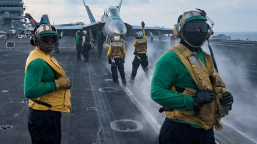 Sailors conduct flight operations on the aircraft carrier USS Carl Vinson (CVN 70) flight deck in the South China Sea