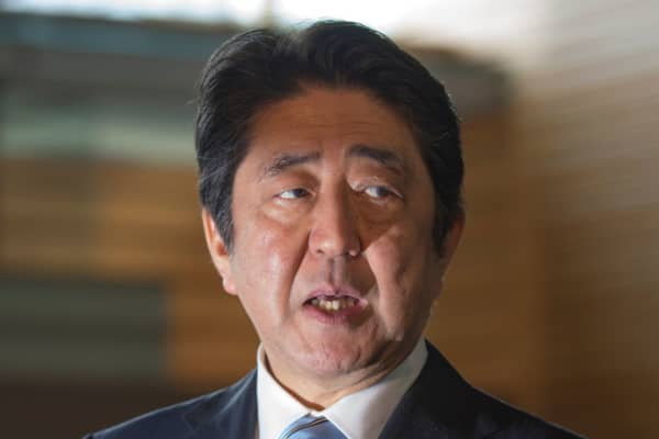 Japan's Prime Minister Shinzo Abe speaks to reporters at his official residence in Tokyo on April 5, 2017.