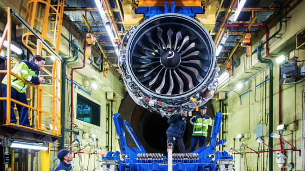 Engineers performing tests on an engine at French aerospace group Safran