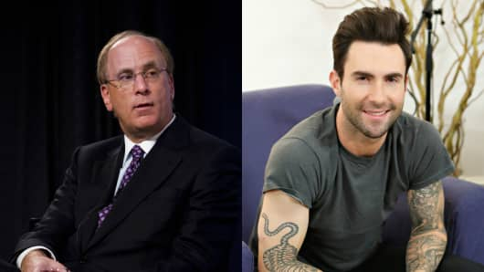 BlackRock's Larry Fink (L) and Adam Levine of Maroon 5 (R)