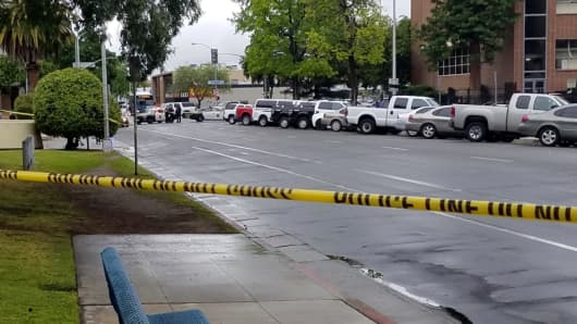 A road is blocked by police tape after a multiple victim shooting incident in downtown Fresno, California, U.S. April 18, 2017.
