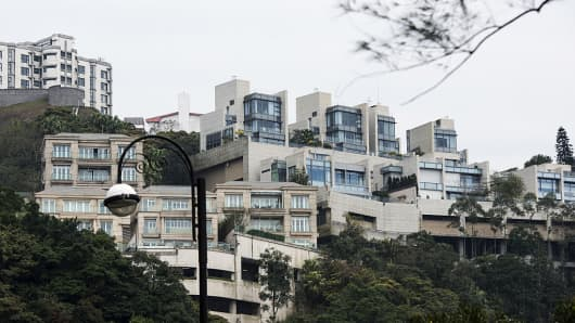 Residential buildings stand in the Peak district of Hong Kong, China, on Saturday, Feb. 20, 2016.