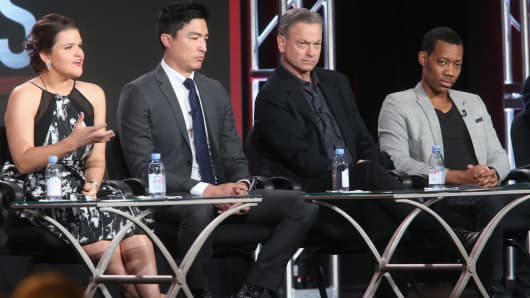 (L-R) Actors Annie Funke, Daniel Henney, Gary Sinise and Tyler James Williams speak onstage during the 'Criminal Minds: Beyond Borders' panel discussion at the CBS/ShowtimeTelevision Group portion of the 2015 Winter TCA Tour at the Langham Huntington Hotel on January 12, 2016.