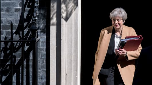 British Prime Minister Theresa May leaves 10 Downing Street in central London on April 19, 2017 ahead of the weekly Prime Minister's Questions session in the House of Commons. British Prime Minister Theresa May called on April 18 for a snap election on June 8, in a shock move as she seeks to bolster her position before tough talks on leaving the EU. MPs are set to vote on the motion following Prime Minister's Questions in the House of Commons.