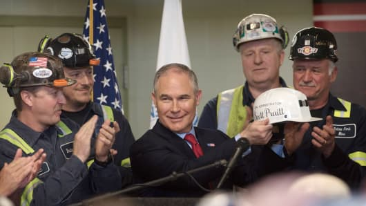 U.S. Environmental Protection Agency Administrator Scott Pruitt holds up a miner's helmet that he was given after speaking with coal miners at the Harvey Mine on April 13, 2017 in Sycamore, Pennsylvania.