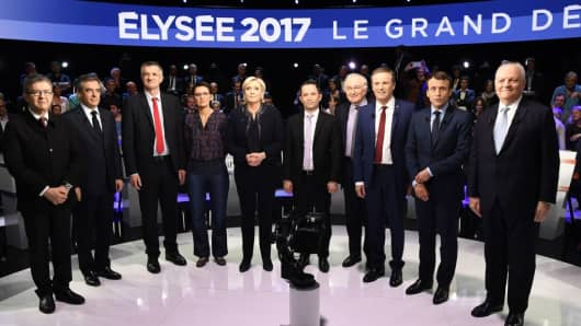 French presidential election candidates pose for a picture prior to a debate organised by the French private TV channels BFM TV and CNews on April 4, 2017 in La Plaine-Saint-Denis near Paris.