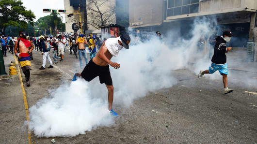 Demonstrators clash with the police during a rally against Venezuelan President Nicolas Maduro, in Caracas on April 19, 2017.