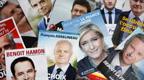 In this photo illustration, posters with the electoral program of the eleven candidates in the French presidential election are seen on April 20, 2017 in Paris, France.