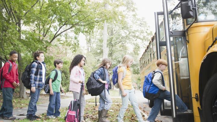 Premium: children getting on a school bus