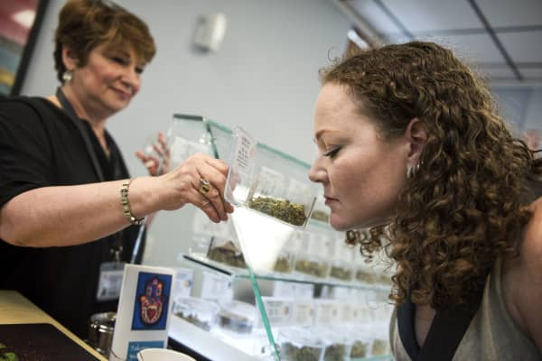 A customer at Takoma Wellness Center in Takoma Park, is shown inventory by Stephanie Kahn, owner of the medical marijuana dispensary.