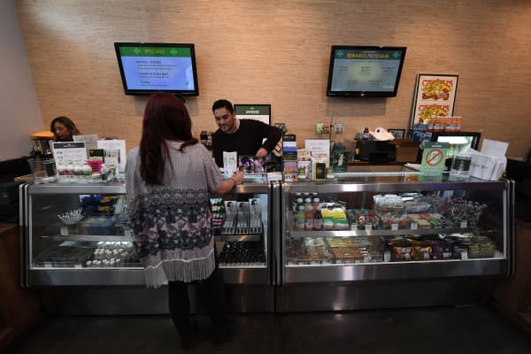 Customers buy marijuana products at the Perennial Holistic Wellness Center which is a medicinal marijuana dispensary in Los Angeles, California.