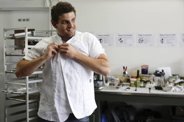 The Herbal Chef CEO and Head Chef Chris Sayegh puts on his uniform.  As more US states move to legalize the use of recreational marijuana, the California chef is aiming to elevate haute cuisine to a new level.
