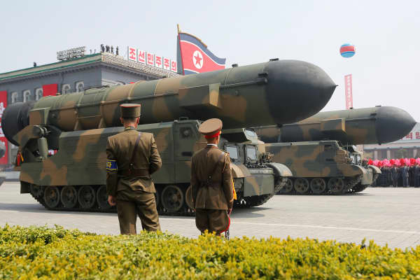 Missiles are driven past the stand with North Korean leader Kim Jong Un and other high-ranking officials during a military parade marking the 105th birth anniversary of North Korea's founding father, Kim Il Sung, in Pyongyang, April 15, 2017.