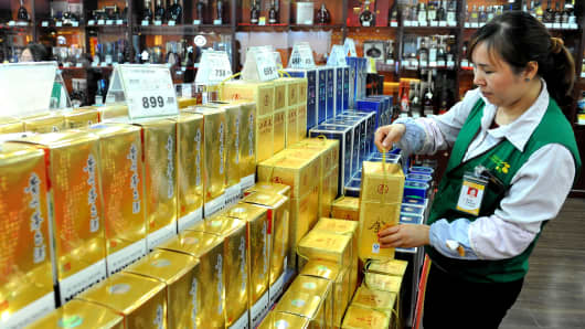 A sale alert arranges a bottle of Maotai at a supermarket on February 9, 2015 in Zhongshan, Guangdong Province of China.
