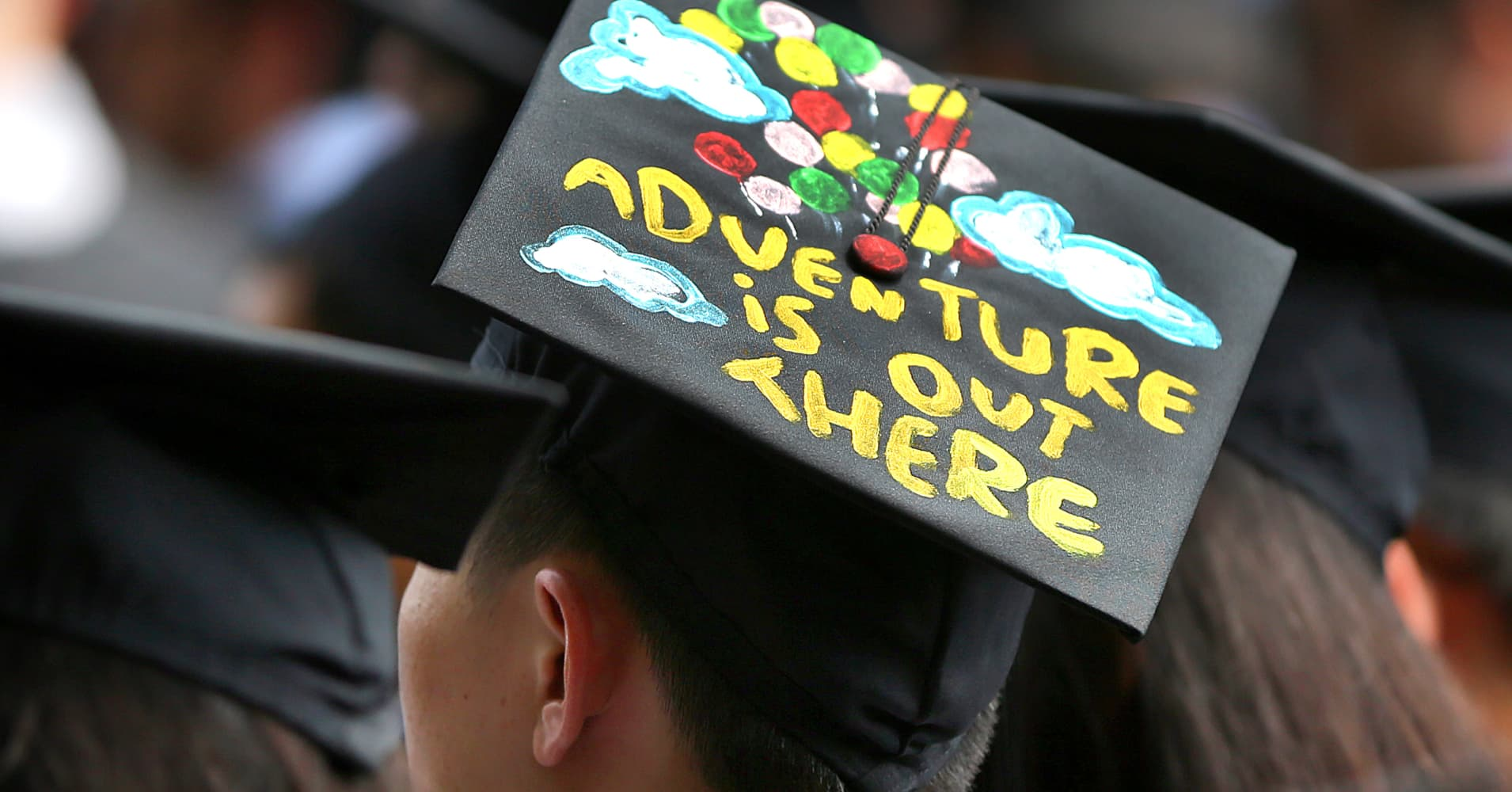 MIT held its graduation on it's campus. A graduate has an inspirational saying on his cap.