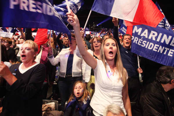 Far right supporters attend a presidential campaign rally by National Front Leader Marine Le Pen at the Dome De Marseille on April 19, 2017 in Marseille, France.