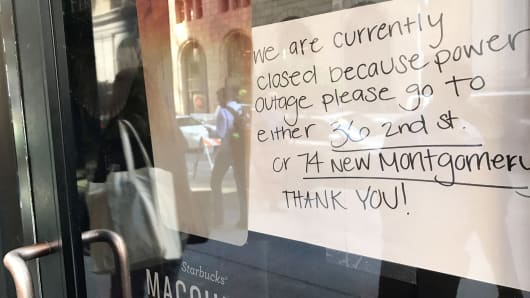 A sign on a Starbucks coffee shop informs customers that the facility is closed due to a power cut, in the financial district of San Francisco, California, April 21, 2017.