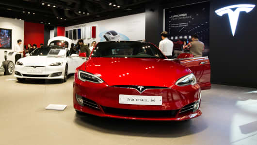 Tesla Model S 90D electric vehicles sit on display.