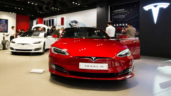 Tesla Model S 90D electric vehicles sit on display.