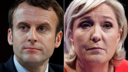 Portraits of the candidates who will run in the second round in the 2017 French presidential election, Emmanuel Macron (L), head of the political movement En Marche !, or Onwards !, and Marine Le Pen, French National Front (FN) political party leader.