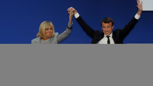 Emmanuel Macron, head of the political movement En Marche !, or Onwards !, and candidate for the 2017 French presidential election, arrives on stage with his wife Brigitte Trogneux to deliver a speech at the Parc des Expositions hall in Paris after early results in the first round of 2017 French presidential election, France, April 23, 2017.