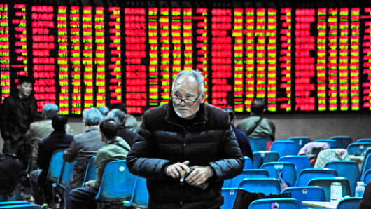 Investors in action at an exchange hall on April 10, 2017 in Nanjing, Jiangsu Province of China. China stocks looked set for their worst day of the year.