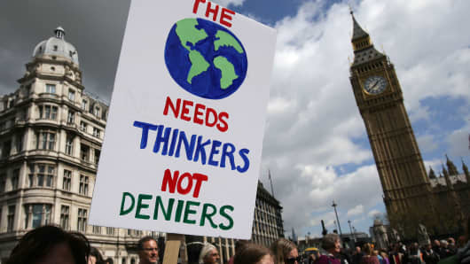A protestor holds a placard as scientists and science enthusiasts participate in the 'March for Science' which celebrates the scientific method, in Westminster, central London on April 22, 2017, Earth Day.