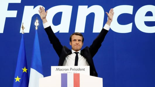 Emmanuel Macron, head of the political movement En Marche !, or Onwards !, and candidate for the 2017 French presidential election, celebrates after partial results in the first round of 2017 French presidential election, at the Parc des Expositions hall in Paris, France April 23, 2017.