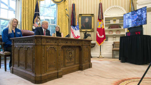 President Donald Trump speaks along with his daughter Ivanka Trump (R) and NASA Astronaut Kate Rubins, during a video conference with NASA astronauts aboard the International Space Station in the Oval Office at the White House April 24, 2017 in Washington, DC.