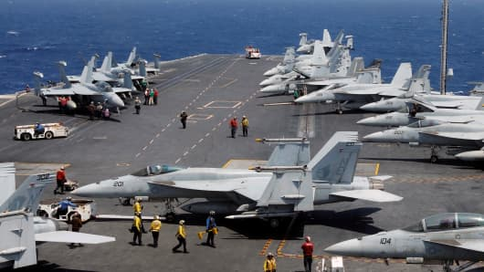 U.S. Navy personnel prepare to launch an F18 fighter jet on the deck of USS Carl Vinson during a routine exercise in South China Sea, March 3, 2017.