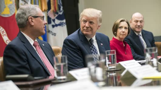 Kenneth Burgess, chairman of the First Capital Bank of Texas, from left, speaks while U.S. President Donald Trump, Dorothy Savarese, chief executive officer of the Cape Cod Five Cents Savings Bank, and Gary Cohn, director of the U.S. National Eco