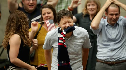 Fans react after watching the U.S. lose to Belgium in the World Cup during a viewing party in the Kogod Courtyard of the Smithsonian National Portait Gallery July 1, 2014
