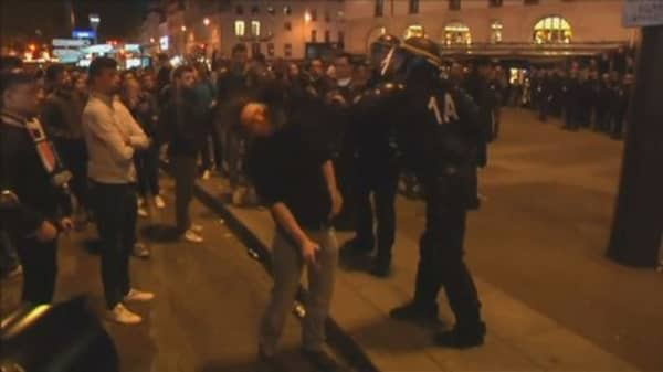 Protesters, police face off in Paris after election results announced