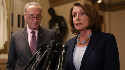 Senate Minority Leader Charles Schumer (L) ,D-N.Y., looks on as House Minority Leader Nancy Pelosi, D-Calif., speaks to reporters during a news conference at the U.S. Capitol in Washington.