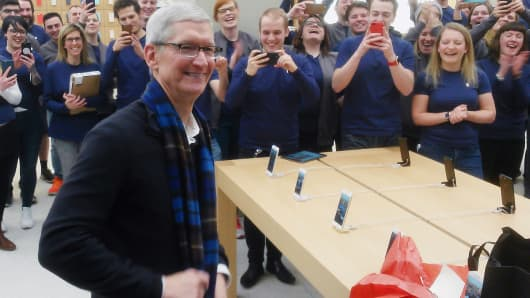 Apple Chief Executive Tim Cook visits an Apple store on Buchanan Street, Glasgow, Scotland, where staff gifted him a scarf and drawing, ahead of being awarded an honorary degree from the University of Glasgow.