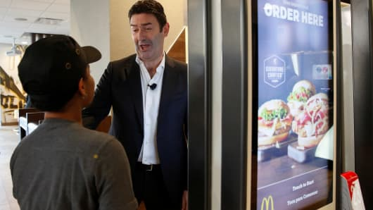 Custom burgers, $1 drinks boost McDonald's sales; shares jump