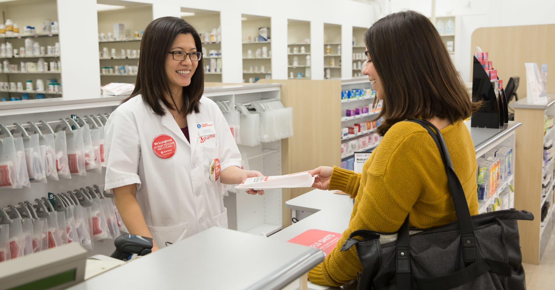 A Kmart pharmacist with a customer.