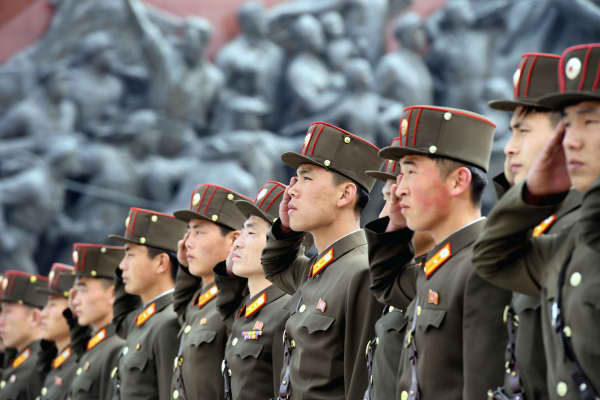 North Korean soldiers salute bronze statues (not pictured) of North Korea's late founder Kim Il-sung and late leader Kim Jong Il at Mansudae in Pyongyang, in this photo released by Kyodo April 25, 2017, to mark the 85th anniversary of the founding of the Korean People's Army.