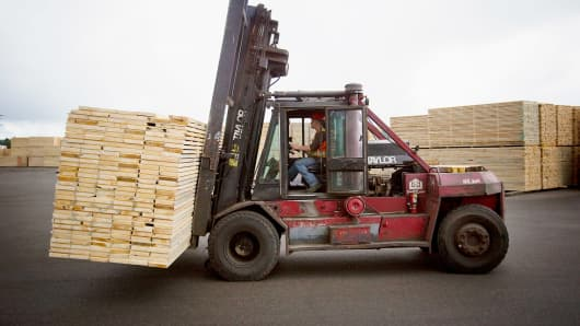 An employee transports cut lumber at the West Fraser Timber Co. sawmill in Quesnel, British Columbia.