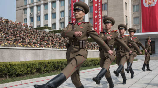 Korean People's Army (KPA) soldiers march to their positions prior to a military parade marking the 105th anniversary of the birth of late North Korean leader Kim Il Sung, in Pyongyang on April 15, 2017.