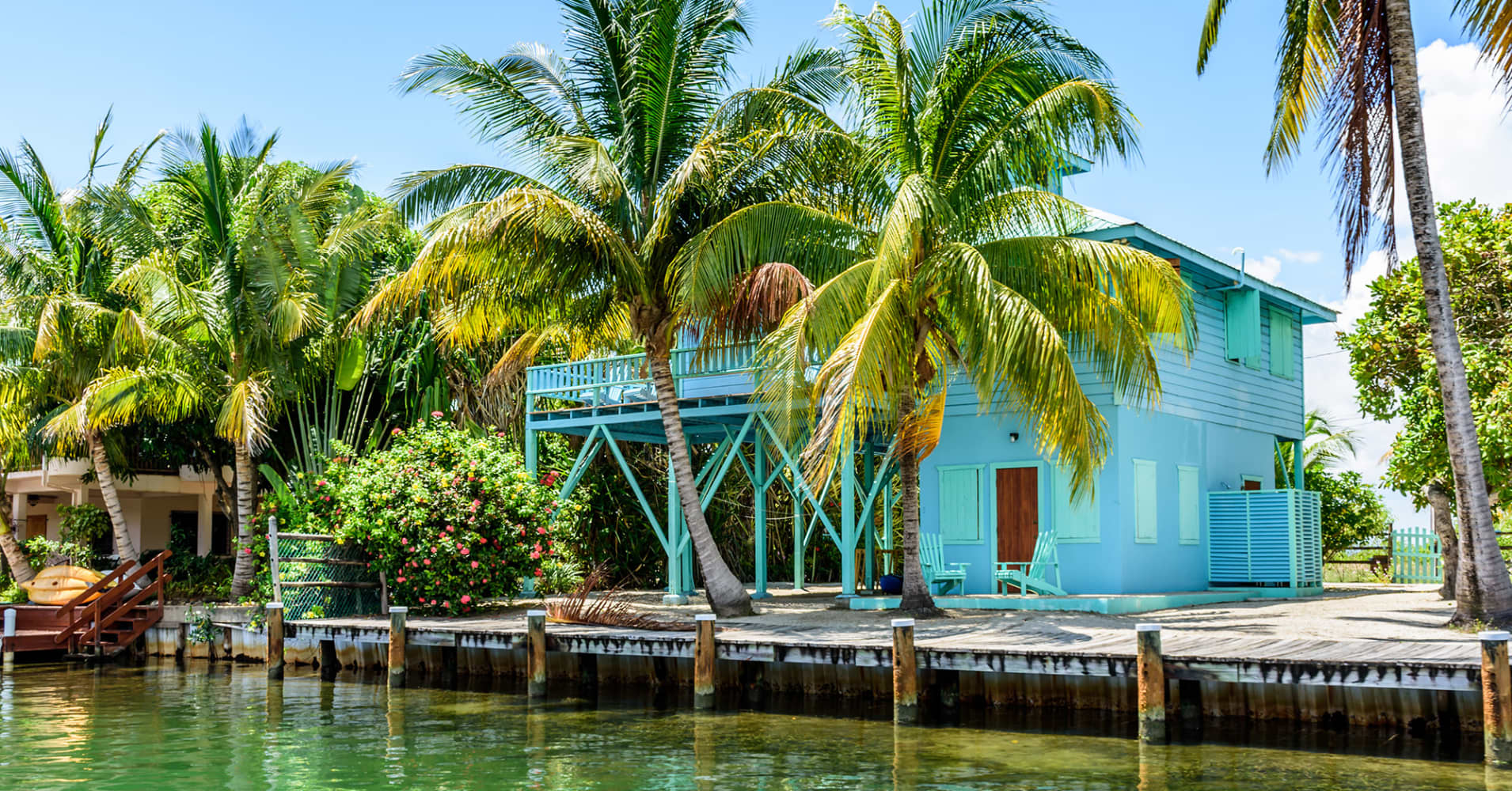 Tropical waterside house on lagoon side of Placencia in Belize, Central America.