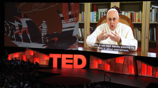 Pope Francis speaks during the TED Conference, urging people to connect with and understand others, during a video presentation at the annual scientific, cultural and academic event in Vancouver.