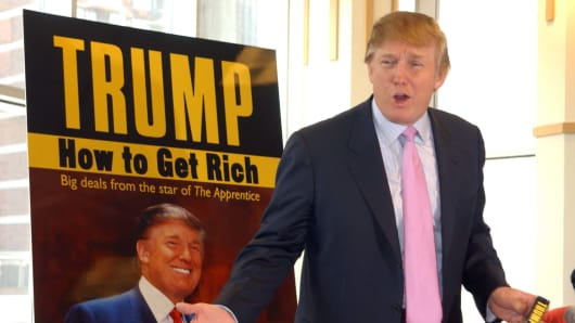 New York real estate developer Donald Trump signs copies of his new book 'How to Get Rich' at the Barnes & Noble-Lincoln Center bookstore in 2004.