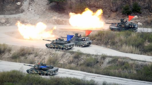 South Korean Army K1A1 and U.S. Army M1A2 tanks fire live rounds during a U.S.-South Korea joint live-fire military exercise, at a training field, near the demilitarized zone, separating the two Koreas in Pocheon, South Korea April 21, 2017.