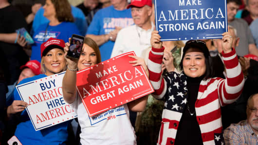 Supporters take selfies and hold placards as President Donald Trump arrives to address a 'Make America Great Again' rally at the Kentucky Exposition Center in Louisville, Kentucky, March 20, 2017.