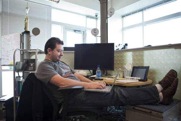 Google software engineer Greg Millam works at his desk in Kirkland Washington.