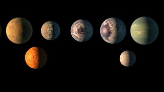 This artist's rendition imagines what the seven planets of the TRAPPIST-1 system might look like.