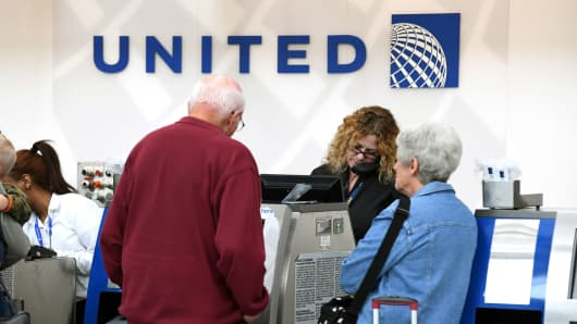 Passengers at a United Airlines counter at O'hare International Airport in Chicago.